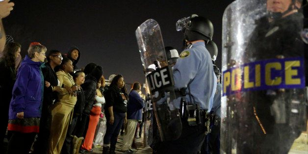 Police and protesters square off outside the Ferguson Police Department, Wednesday, March 11, 2015, in Ferguson, Mo. Earlier