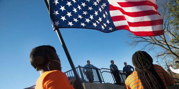 FERGUSON, MO - MARCH 15:  Demonstrators confront police during a protest outside the Ferguson police station on March 15, 201