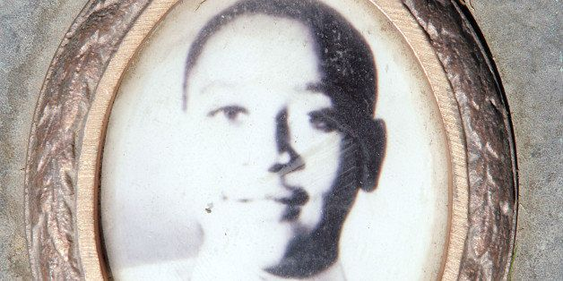 ALSIP, IL - MAY 4:  A photo of Emmett Till is included on the plaque that marks his gravesite at Burr Oak Cemetery May 4, 200