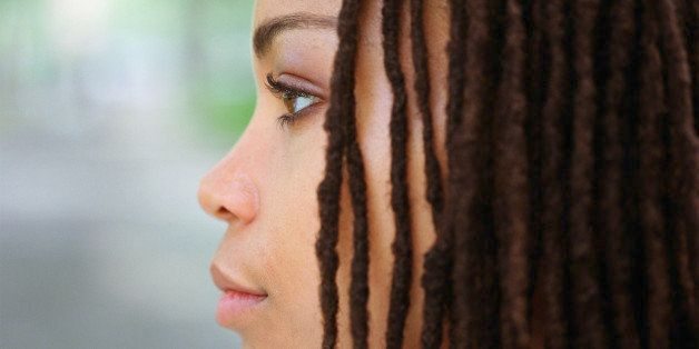Young woman with hair in dreadlocks, profile, close-up