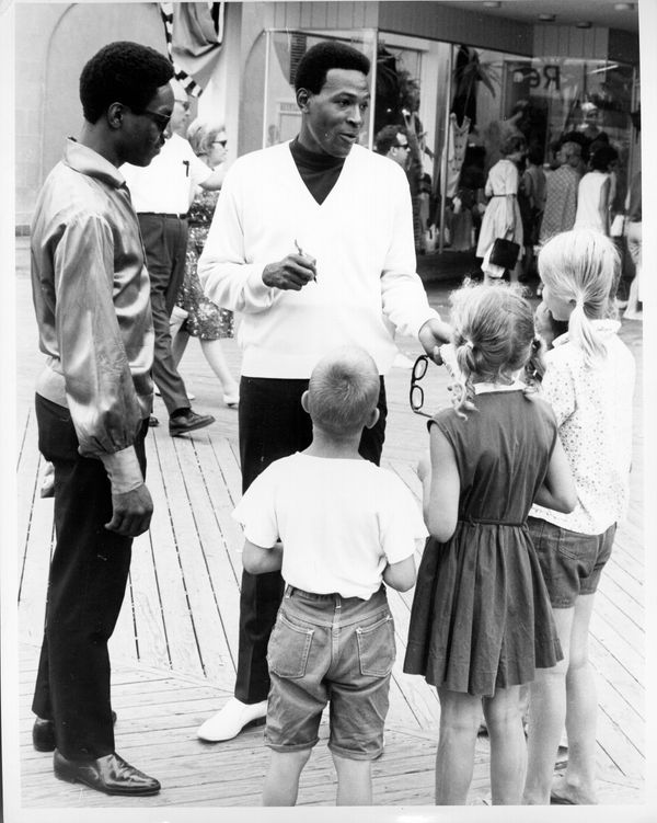 Soul singer Marvin Gaye enjoys an ice cream cone as he strolls down the boardwalk in circa 1965 in Atlantic City, New Jersey.