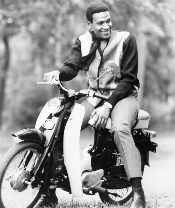 R&B singer Marvin Gaye poses for a portrait leaning against a mo-ped scooter in circa 1967. (Photo by Michael Ochs Archives/G