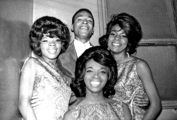 R&B singer Marvin Gaye poses for a portrait backstage at the Apollo Theater with female R&B vocal group 'Martha & The Vandell
