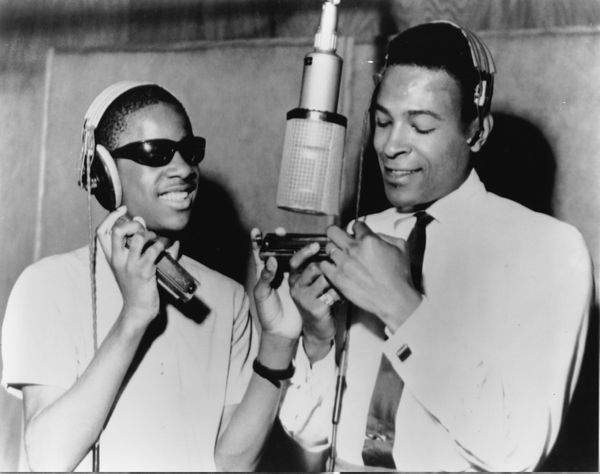 Stevie Wonder and Marvin Gaye around a microphone at the Motown recording studio in Detroit in 1965 in the United States. (Ph