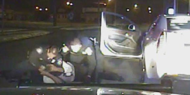 In this Jan. 28, 2015, frame from a dashcam video provided by the Inkster Police Department, an officer punches Floyd Dent ma