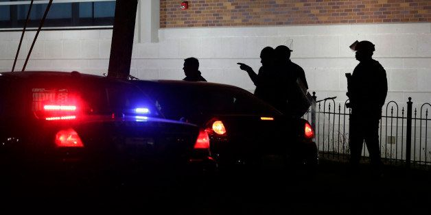 Police gather outside the Ferguson Police Department Thursday, March 12, 2015, after two police officers were shot according