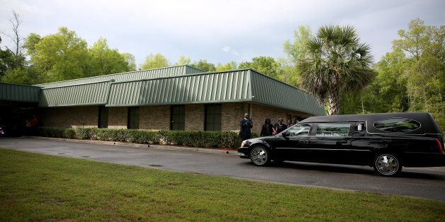SUMMERVILLE, SC - APRIL 11: The hearse carrying Walter Scott arrives arrives at the W.O.R.D. Ministries Christian Center for