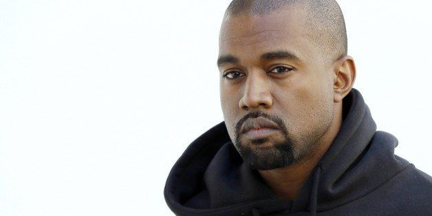 American rapper Kanye West poses before Christian Dior 2015-2016 fall/winter ready-to-wear collection fashion show on March 6