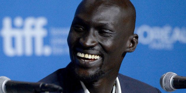 TORONTO, ON - SEPTEMBER 08:  Actor Ger Duany speaks onstage at 'The Good Lie' Press Conference during the 2014 Toronto Intern