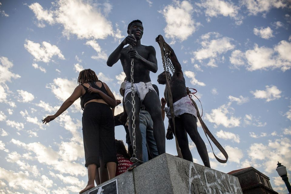 Students cheer from where the Cecil Rhodes statue stood moments before after it was removed from the University of Cape Town