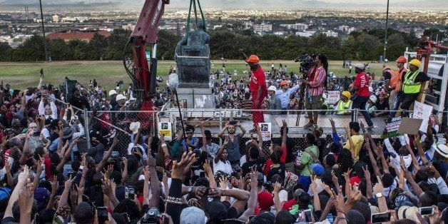 CAPE TOWN, SOUTH AFRICA - APRIL 09: Students cheer as the Cecil Rhodes statue is being removed from the University of Cape To