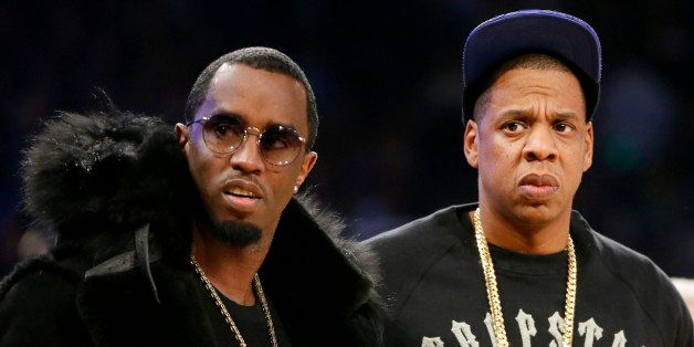 """Rap moguls Sean """"Puffy"""" Combs, left, and Jay-Z attend the NBA All-Star basketball game, Sunday, Feb. 15, 2015, in New York. ("""