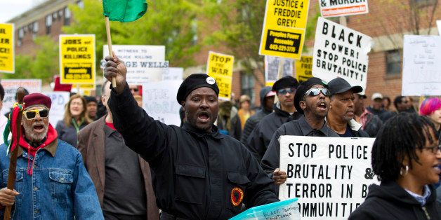 Demonstrators protest in the streets as they march for Freddie Gray to Baltimore's City Hall, Saturday, April 25, 2015. Gray