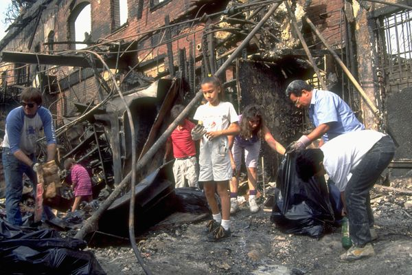 A group of people clean up a burned building after the riots following the Rodney King trial in Los Angeles, April 30, 1992.
