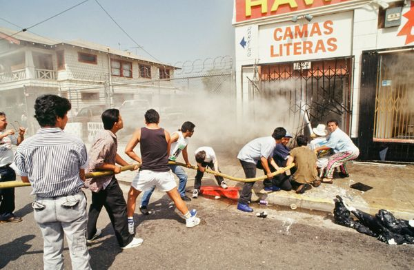 Several area residents attempt to put out a fire in the mostly hispanic area of Los Angeles, Pico/Union. (Ted Soqui/Corbis)