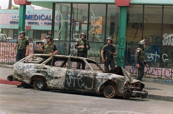 Los Angeles police officers patrol a street,  May 3, 1992 in Los Angeles. (HAL GARB/AFP/Getty Images)