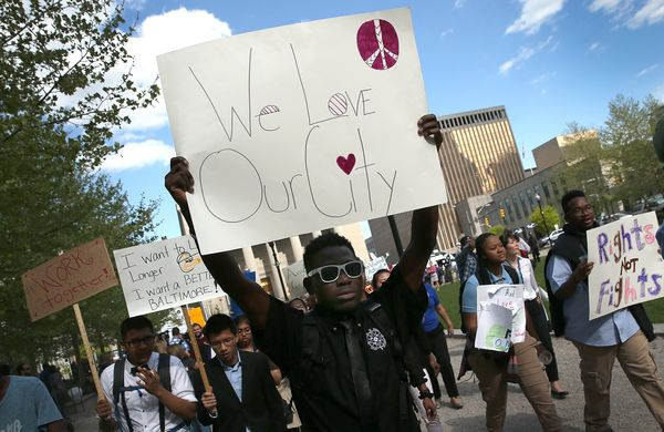 "Students from Digital Harbor High School chant ""We Love Baltimore"" as they march outside City Hall April 29, 2015 in Baltimor"