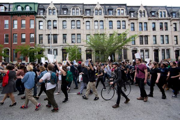 Protestors march to City Hall on Wednesday, April 29, 2015, in Baltimore. Hundreds of protesters, many of them students weari