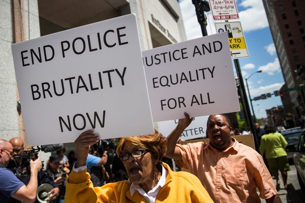 People participate in a rally for the family of Freddie Gray outside the Maryland state's attorney's office on April 29, 2015