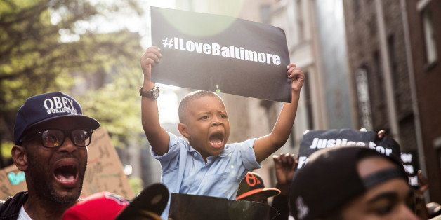 BALTIMORE, MD - APRIL 30:  Protesters march from the Sandtown neighborhood to City Hall demanding better police accountabilit