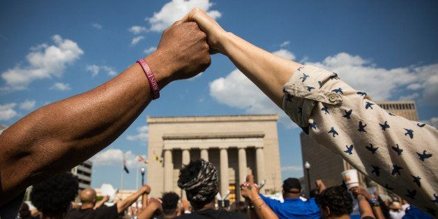 BALTIMORE, MD - MAY 03:  People hold hands during a rally lead by faith leaders in front of city hall calling for justice in