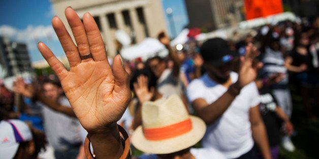 People pray during a rally at City Hall, Sunday, May 3, 2015, in Baltimore. Hundreds of jubilant people prayed and chanted fo