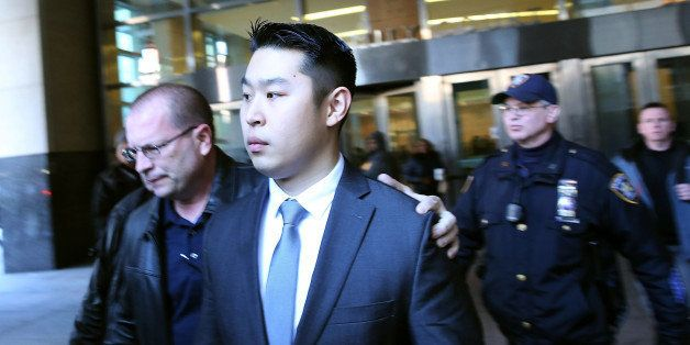 NEW YORK, NY - FEBRUARY 11:  New York City police officer Peter Liang is escorted out of court after he was charged with mans