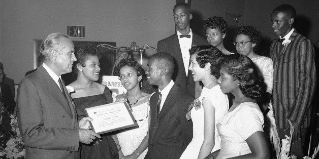 New York Gov. W. Averell Harriman passes out awards to nine black students who were the first to attend Central High School i