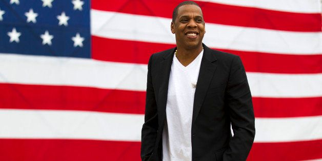 "FILE - In this May 14, 2012 file photo, entertainer Shawn ""Jay-Z"" Carter smiles in between interviews, after a news conferenc"