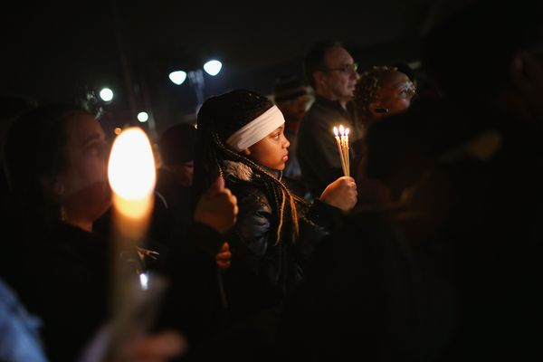 FERGUSON, MO - MARCH 12: Demonstrators hold a prayer service near the police station on March 12, 2015 in Ferguson, Missouri.