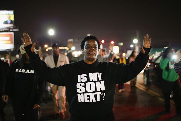 FERGUSON, MO - MARCH 12: Demonstrators protest in front of the police station on March 12, 2015 in Ferguson, Missouri. Two po