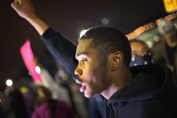 FERGUSON, MO - MARCH 12: Demonstrators protests in front of the police station on March 12, 2015 in Ferguson, Missouri. Two p