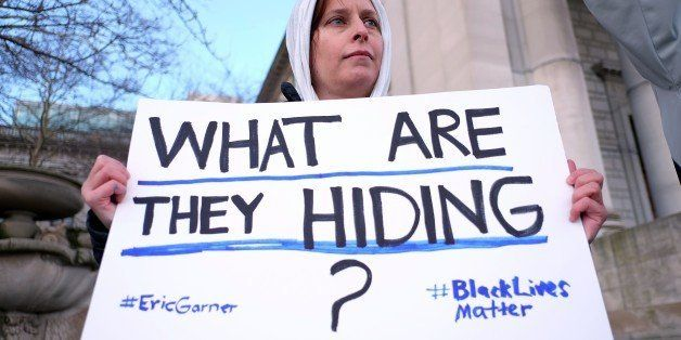 A protester displays a placard during a demonstration outside the courthouse in New York's borough of Staten Island on Januar