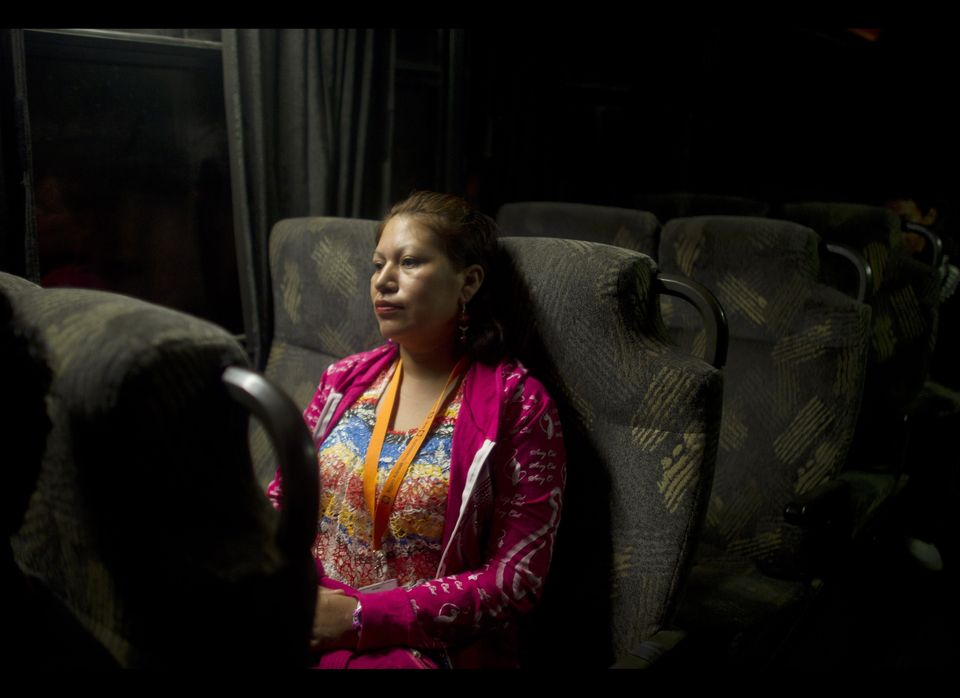 Amelia Reyes-Jimenez rides the bus to work in Zapopan, Mexico, Friday, Aug. 17, 2012. Reyes-Jimenez carried her blind and par