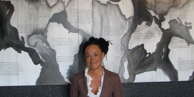 In this photo taken July 24, 2009, Rachel Dolezal, a leader of the Human Rights Education Institute, stands in front of a mur