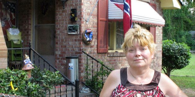 Annie Chambers Caddell stands outside her home in Summerville, S.C., on Thursday, Oct. 14, 2010. The Confederate flag behind