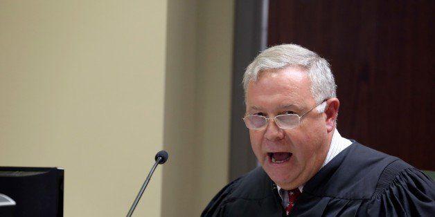 NORTH CHARLESTON, SC - JUNE 19:  Judge James Gosnell speaks as Dylann Roof appears via video uplink from the detention center