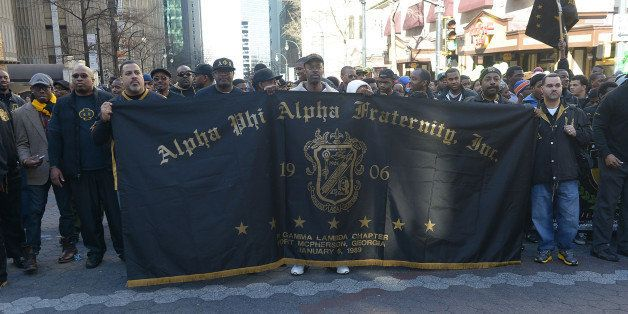 ATLANTA, GA - JANUARY 20:  Members of Alpha Phi Alpha Fraternity, Inc. participates in the 2014 Martin Luther King, Jr. March