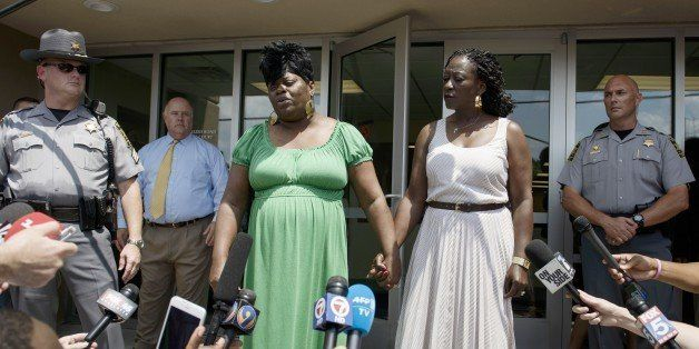 Nadine Collier (C) speaks about her mother, church shooting victim Ethel Lance, after a bond hearing at the Charleston County