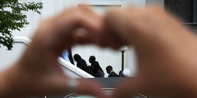 CHARLESTON, SC - JUNE 27:  Heather Hayward forms a heart with her hands as mourners file in for the funeral of Cynthia Hurd,