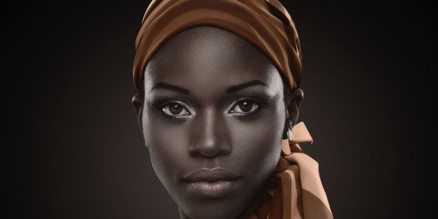 Portrait of a beautiful African woman with orange scarf.