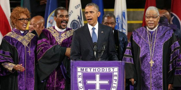 CHARLESTON, SC - JUNE 26:  President Barack Obama sings 'Amazing Grace' as he delivers the eulogy for South Carolina state se