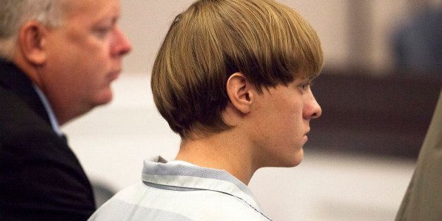 CHARLESTON, SC - JULY 16: Dylann Roof (R), 21, listens to proceeding with assistant defense attorney William Maguire during a