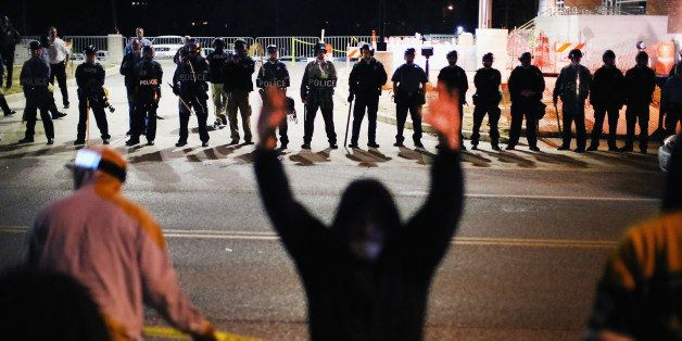 FERGUSON, MO - OCTOBER 22:  Police face off with demonstrators outside the police station as protests continue in the wake of