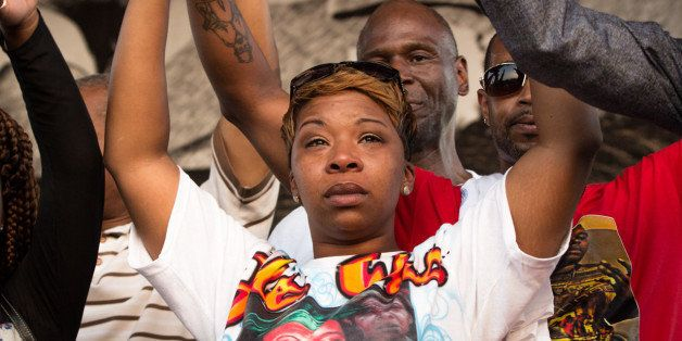 "Michael Brown's mother Lesley McSpadden wearing a memorial T-shirt with her son's photo and the words, ""He Was Special 2"