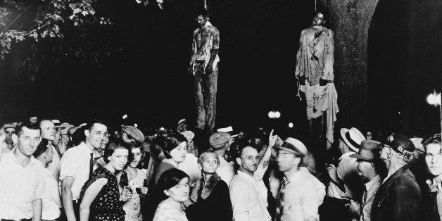 A crowd gathering to witness the killing of Thomas Shipp and Abram Smith, two victims of lynch law in Marion, Indiana, 7th Au