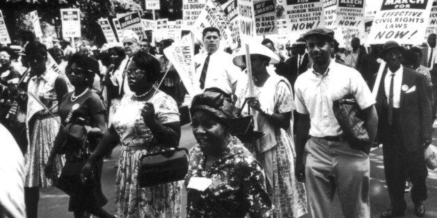 Demonstration in Washington, which gathered 200,000 blacks and whites, and during which President Kennedy announced a program