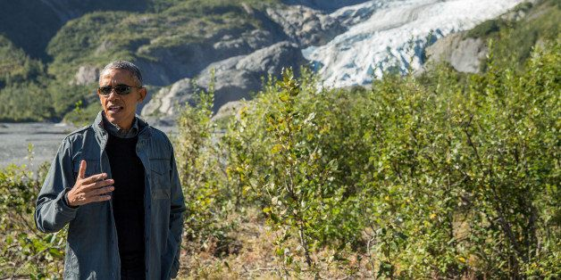 President Barack Obama speaks to members of the media while on a hike to the Exit Glacier in Seward, Alaska, Tuesday, Sept. 1