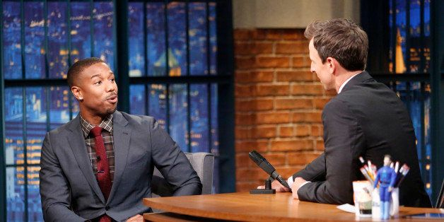LATE NIGHT WITH SETH MEYERS -- Episode 242 -- Pictured: (l-r) Actor Michael B. Jordan during an interview with host Seth Meye