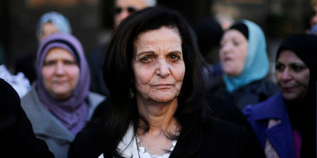 Rasmea Odeh listens to supporters after leaving federal court in Detroit Thursday, March 12, 2015. A judge sentenced the Chic